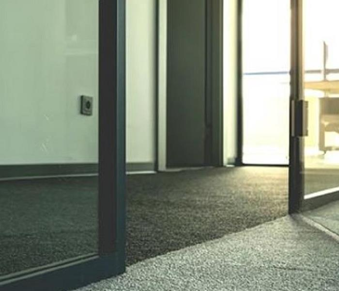 Office entrance, glass door, carpeted hallway