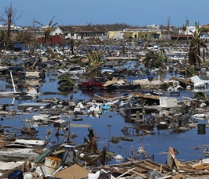 hurricane destruction including debris, vehicles stranded, destroyed homes and excessive water
